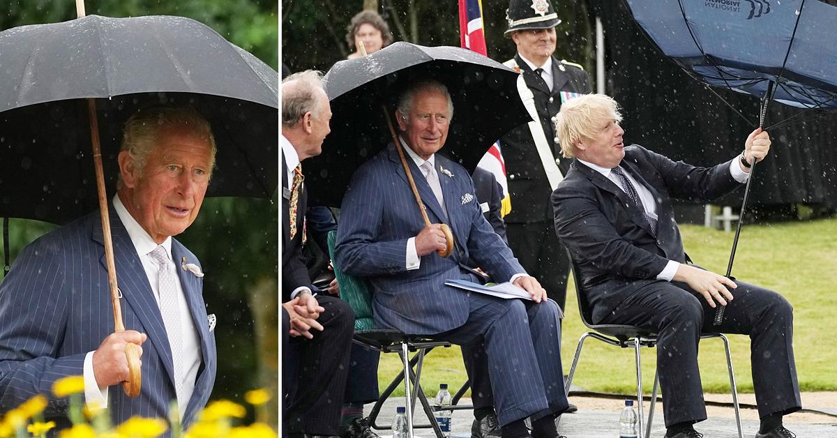 prince charles and boris johnson struggles with umbrella at the national memorial arboretum
